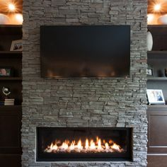 Family First - traditional - Family Room - Vancouver - Kenorah Design + Build Ltd. Fireplace Tv Wall, Fireplace Remodel, Fireplace Surrounds, Fireplace Design, Fireplace Ideas, Mantel Ideas, Propane Fireplace, Stacked Stone Fireplaces, Modern Fireplaces