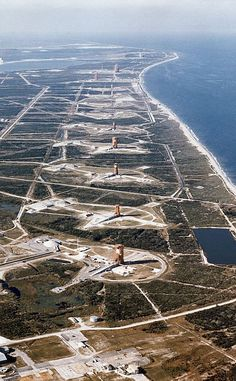 In this aerial photo taken on November 13, 1964 we see NASA's 'missile row' at the Cape Canaveral Air Force Station in Florida. The view is looking north, with the Vehicle Assembly Building (VAB) under construction, in the upper left hand corner.
