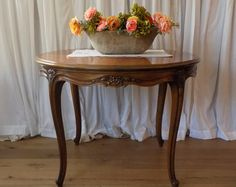 Round wood table with floral carvings, French, perfect entry table, needs bigger flower arrangement, maybe good for breakfast nook too!