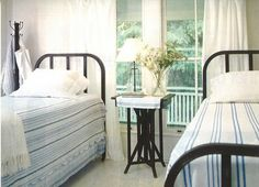 I have 2 old metal twin beds at the lake... this is a possible look for one room.  Me likey!