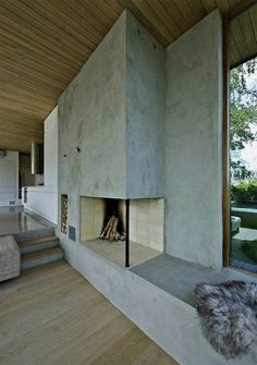 Cement Fireplace: Contrasting elements & textures, natural & built