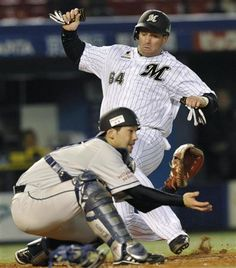 Yuuji Kaneko relays to Yasuyuki Kataoka who fires to the plate, and Ginjiroh Sumitani blocks it to cut down Josh Whitesell trying to score in the 2nd inning at QVC Marine Field on Thursday, April 11, 2013.