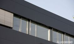 BLACK ELEGANCE - Project: IMF Tertia, Lannach | Austria - Architects: Hermann Eisenköck Architekten, Graz | Austria - Façade System: Glued - Year of Construction: 2006 - Product: ALUCOBOND® black & silvermetallic - Photos: Amari Austria