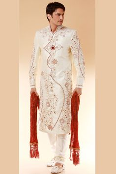 Look hot with our designer White Indian sherwani for men. This hot sherwani is white colored with outstanding red embroidery work on sherwani. If you look what to wear on your wedding then stop search and have a look at this hot sherwani. Plus you will get complete package which is mentioned below with no additional charges. Order now from our hot collection of  Indian Wedding sherwanis.  Instead Of $350 You can get this in $280.  For any queries email us at support@mensweddingsherwanis.com