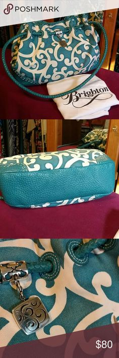 """Brighton Lilly Bag - excellent condition Teal and white bag, teal leather bottom and handles. Hardware in excellent condition. Interior, no marks or stains,  zip compartment and 2 pockets. One small ink spot on exterior of bag see my pointer in pic 3 ( far right of pic) comes with original dust bag. Has always been stored in dust bag and original box. Beautiful bag! 15""""  wide x 10"""" high x 5"""" deep. Brighton Bags Shoulder Bags"""