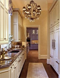 Stunning Butler Pantry ~ love the chandelier ~ interior design ideas and decor {kitchen}
