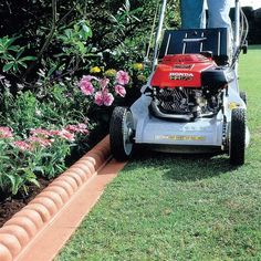 This innovative Mow Over Victorian Lawn Edging means you can mow right over the edge of the specially designed mowing strip which makes maintaining neat. Lawn Edging, Garden Edging, Garden Borders, Lawn And Garden, Mowing Strip, Garden Shower, Garden Online, Victorian Gardens, Lawn Maintenance