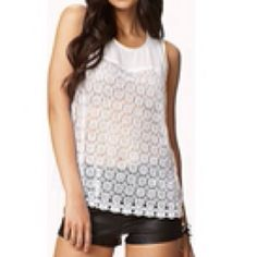 Forever 21 Eyelet Embroidered Tank Top NWT This beautiful top is completely sold out online-this is your chance to get it NWT and at a discounted price from my closet! Front is a see through eyelet lace looking embroidered design and the bib neck and back are sheer with a cute zipper on the upper back.  Don't let the last one go before you snatch it! Size Medium.  Fits true to size Forever 21 Tops Tank Tops