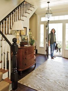 Idea for refinishing ugly honey oak banisters that are in a lot of tract homes these days.  Looks good with that dark hardwood flooring.