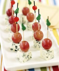 Pickled Grape and Blue Cheese Skewers. Ingredients include water, cloves, red wine vinegar, coriander seeds, mustard seeds, allspice berries, bay leaves, red seedless grapes, blue cheese