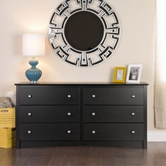 Increase storage space and add stylish class to the look of any bedroom with this versatile black six-drawer dresser. The brushed nickel hardware and elegant black finish are the perfect accompaniments for your modern bedroom collection.
