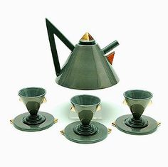 Porcelain tea-pot with three cups saucers Nefertiti glazed in gray with gilded accents design Matteo Thun 1981 for Memphis / Italy Ceramic Teapots, Porcelain Ceramics, Ceramic Vase, Tassen Design, Pottery Videos, Memphis Design, Teapots And Cups, Tea Art, Vintage Bottles