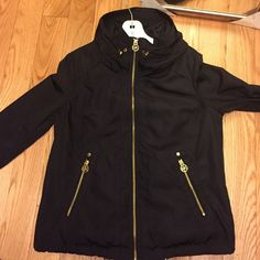 Michael Kors Jacket Black XS light Michael Kors Jacket. Great for rainy days! Has a hidden hood in collar and can be cinched in at the bottom. Can be worn with a full sleeve or 3/4 as shown in picture #4. Worn several times, but in perfect condition. Price is negotiable, please make an offer. Michael Kors Jackets & Coats Utility Jackets