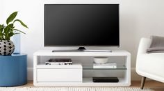 This modern TV unit has a high white gloss finish and a tempered glass clear shelf. The Alessia Compact White Gloss TV Table is smaller in size but big in style and practicality. White Gloss Tv Unit, White Tv Unit, Contemporary Tv Units, Modern Tv Units, Living Room Tv Unit, Living Room Sets, Living Area, Ikea Hacks, Small Tv Unit