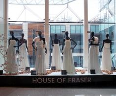 House of Fraser Bridal Window Westfield 2012    Black glossy mannequins really make those gowns pop! Find these at MannequinMadness.co