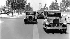 "1930's Car Dashcam / Rumble Seat Cam - Classic American Cars.....An early ""dashcam"" style film, showing a trip along Wilshire Blvd, Beverly Hills, California in the mid 1930's. The rear facing camera captures many classic vehicles from the 1920s and 1930s including a Rolls Royce, a tow truck with a vehicle clearly damaged from an accident, and of course many Ford and General Motors vehicles that were so common during this period. No talking just the clicking of the tranny...funny to watch!"