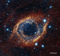 A new view of the Helix Nebula acquired with ESO's VISTA telescope in infrared light reveals strands of cold nebular gas that are mostly obscured in visible light images of the Helix