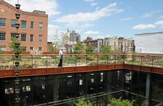 Across the inner courtyard, you can see people hanging out in the rooftop garden.