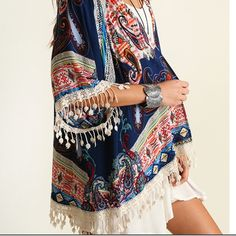 Navy/red patterned fringed Kimono. 🆕.HP🎉🎉6/6 Gorgeous Boho Fringed Kimono. Navy/red, patterned. White fringe. True to size but roomy. Comes in small, med and large. Please Do Not Buy This Listing. Specify size and I will make you a listing. Bundle for less. Free gift too! 🆕 🎉🎉HP Total Trendsetter by Cheryl thanks dear. 6/6 🎉🎉reduced for holiday. Umgee Jackets & Coats