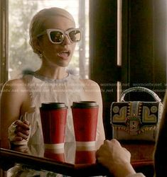 Chanel's feather dress and patterned bag on Scream Queens.  Outfit Details: http://wornontv.net/53819/ #ScreamQueens