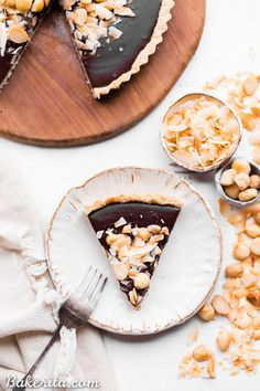 This Dark Chocolate, Coconut & Macadamia Nut Tart is decadent, delicious and easy to make. It has a coconut crust that's filled with a luscious chocolate ganache and topped with toasted coconut and macadamia nuts. You'd never guess that this nutty tart is gluten-free, vegan, Paleo, and refined sugar-free!