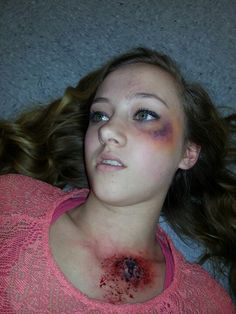 Bullet wound and black eye makeup :S