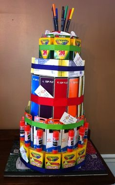 "How fun is that? Like a diaper cake for teachers! :) I'd definitely have to ""cutsie"" it up a bit...but this would make a great Teacher Appreciation gift, or welcome ""basket"" for a new employee."