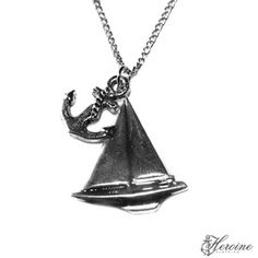 New Sterling sailboat and small anchor necklace! Heroine loves to set sail! Anchors away with this sterling silver sailboat charm and anchor necklace on curb chain with our heroine clothing small acrylic jewelry tag! No one will have one this this!