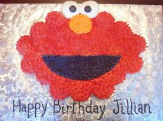 Elmo Cupcake Cake I've made this cupcake cake a few times but I am SICK of making red icing!!! So this time I piped white icing on and...
