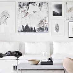 White couch and art wall