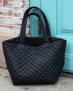 MZ Wallace Black Oxford Nylon Metro Tote on the sidewalk.