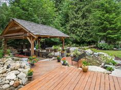 Contemporary Landscape/Yard with exterior stone floors, Pond, Tropitone MainSail Dining Arm Chair, Gazebo, Outdoor kitchen