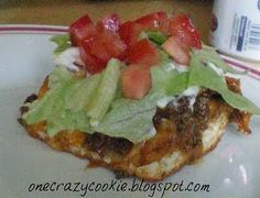 taco biscuit bake----one of our family's favorites!  I use refried beans instead of chili and crush fritos on top...yum!