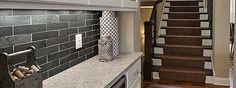 Black Slate Subway Backsplash Tile Idea Elegant looking black color, rough surface 2x8 subway slate backsplash tile with kashmir white kitchen granite countertop and white kitchen cabinets.