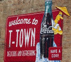 """Welcome to T-town Coca Cola sign that adorns the wall of Tuscaloosa's Mellow Mushroom Pizza. Home of great pizza and one of the best craft beer bars in the city. Crimson Tide Football, Alabama Football, Alabama Crimson Tide, College Football, Coca Cola, College Road Trip, Tuscaloosa Alabama, Thing 1, Sweet Home Alabama"
