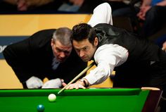 ronnie O'sullivan: Ronnie O'Sullivan lines up a shot closely watched by referee Jan Verhaas