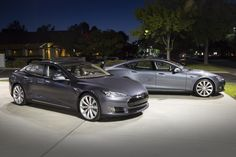 Tesla Model S. The old grey (background) and the new steel grey (foreground) Model S. (2014)