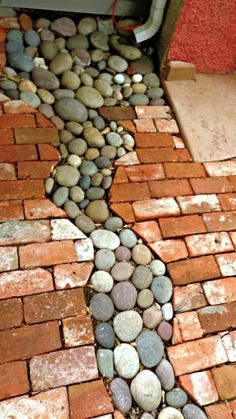 Great path idea! Rock & brick pathway allows downspout to drain with no mud.