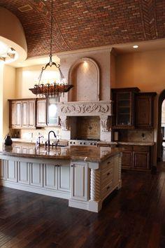 Alder cabinets cream and glazed island with brick barrel above!! At the villa Tuscano home we built.