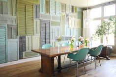 How cool! Fill a wall with painted old mis-matched shutters!