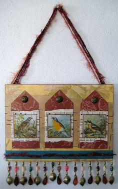 """I'm all into the birds lately, especially since purchasing a Dover clip-art book that's all about birds.  Love 'em.  The bird pictures are covered with 2″ square """"Memory Glass"""" which is made by Ranger.  (Love this stuff, too.)"""