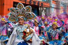 The Sinulog is an annual festival held on the third Sunday of January in Cebu City, Philippines. The festival commemorates the Cebuano people's pagan origin, and their acceptance of Roman Catholicism. The festival features a street parade with participants in bright coloured costumes dancing to the rhythm of drums, trumpets and native gongs