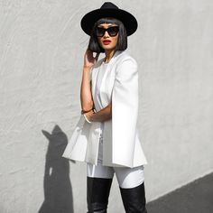 Micah in the Pearl And Rubies white cape blazer.