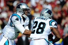 LANDOVER, MD - NOVEMBER 04: Cam Newton #1 of the Carolina Panthers hands the ball off to teammate Jonathan Stewart #28 in the first half against the Washington Redskins at FedExField on November 4, 2012 in Landover, Maryland. (Photo by Patrick McDermott/Getty Images)