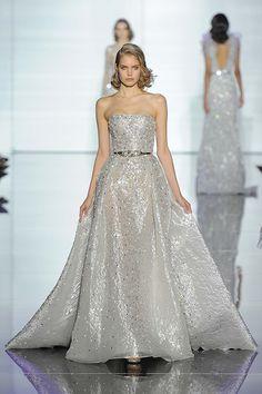 Strapless silver wedding dress with belt. Designed by Zuhair Murad
