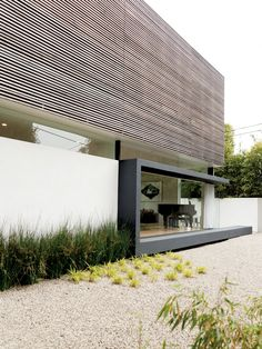 The hardscaping helps keep water use to a minimum. The Lais used gravel—accented…