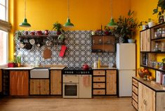 Relic Interiors bespoke reclaimed timber kitchen with spanish tiling & industrial lighting. Timber Kitchen, Industrial Kitchen Design, Kitchen Flooring, Kitchen Interior, Kitchen Decor, Kitchen Cabinets, Kitchen Ideas, Kitchen Colour Schemes, Kitchen Colors
