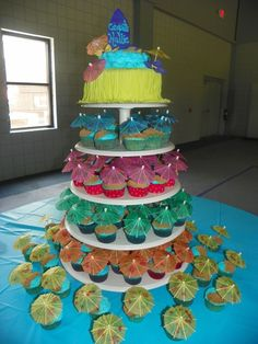 Luau Cake cup cakes, blue frosting, brown sugar sand, umbrella