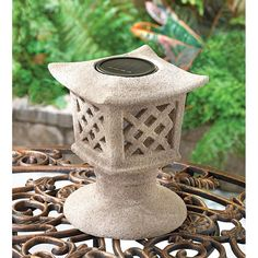 Solar Pagoda Light  Ancient beauty meets modern technology in this graceful solar pagoda lamp! Resembling a sand-cast temple lantern, the lattice cage of this decorative garden light features a super-bright bulb for bright nighttime illumination. Solar panel at top uses sunlight to charge the lantern. No plugs or cords required!   @  amazingwebshopperonline.com