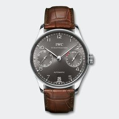 IWC Schaffhausen Portuguese Automatic w/ Black face and brown leather band. IW500106